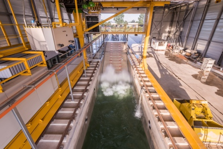 Delta Flume: Large scale experiments of overtopped wave loads on storm walls